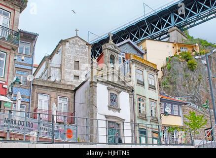 PORTO, PORTUGAL - APRIL 30, 2012: The small Church, named Capela da Lada, on Ribeira embankment at the Luis I Bridge, - Stock Photo