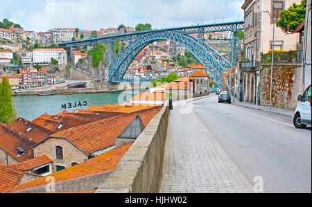 PORTO, PORTUGAL - APRIL 30, 2012: The Luis I Bridge over the Douro river is one of the notable city landmarks, on - Stock Photo