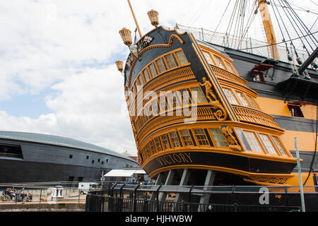 The stern of HMS Victory in Portsmouth the flagship of Lord Nelson's fleet and famous for its role in the Battle - Stock Photo