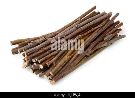 Stack of wooden twigs isolated on white - Stock Photo