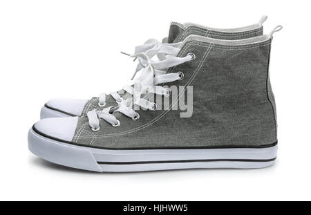 Pair of canvas sport shoes isolated on white - Stock Photo