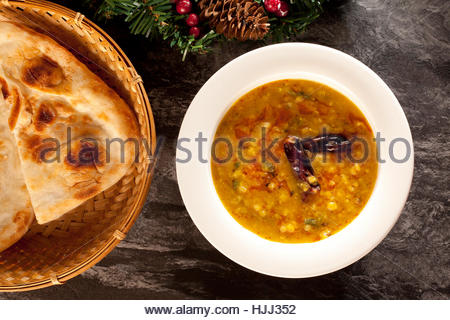 Indian dal with nan - Stock Photo