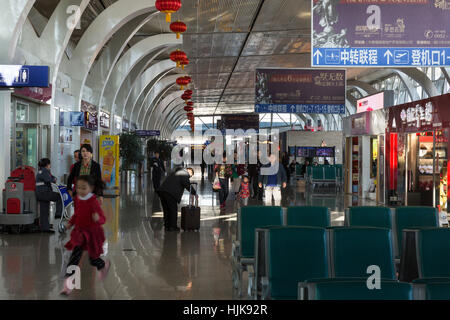Passengers in Departure Hall at Yinchuan Hedong International Airport, Ningxia province,,China - Stock Photo