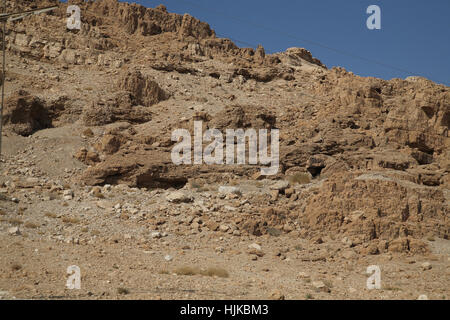 Qumran by the Dead Sea, a hole right of center which is cave 11 where the Temple Scroll and parts of 24 other scrolls - Stock Photo