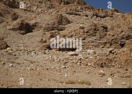 Qumran by the Dead Sea, a hole on the right which is cave 11 where the Temple Scroll and parts of 24 other scrolls - Stock Photo
