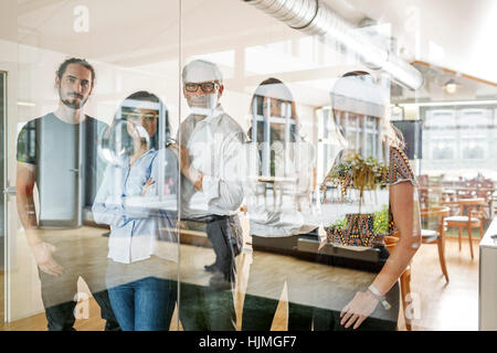 Portrait of confident business team in modern office - Stock Photo