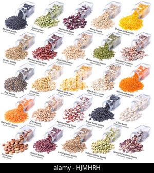 different legumes in glass bottles isolated on white background - Stock Photo