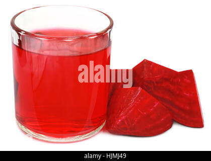 Fresh Beet with juice in glass over white background - Stock Photo
