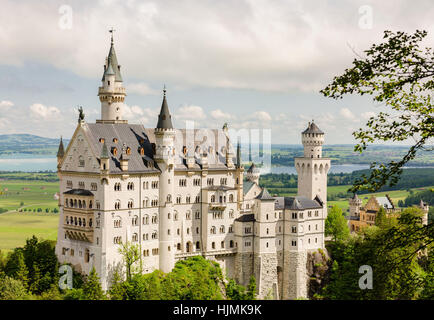 Neuschwanstein Castle is a nineteenth-century Romanesque Revival palace on a rugged hill near Fussen in southwest - Stock Photo