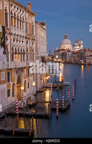 Twilgiht over the buildings along the Grand Canal with Santa Maria della Salute beyond, Venice, Veneto, Italy - Stock Photo