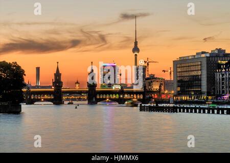 Oberbaum Bridge , Oberbaumbruecke, sunset, Alex TV tower,  Living Levels tower, River Spree, Aquarella - Stock Photo