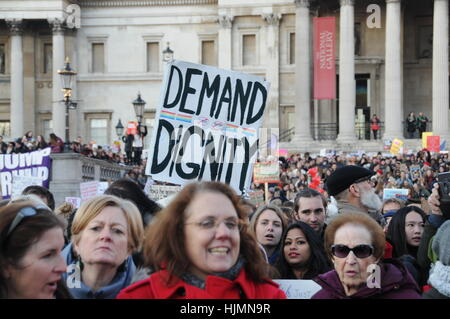 Protesters from the 2017 Women's March, against US President, Donald Trump, in London's Trafalgar Square. - Stock Photo