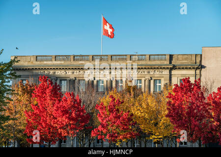 Embassy of Switzerland in Berlin with the Swiss national flag , autumn, Berlin - Stock Photo
