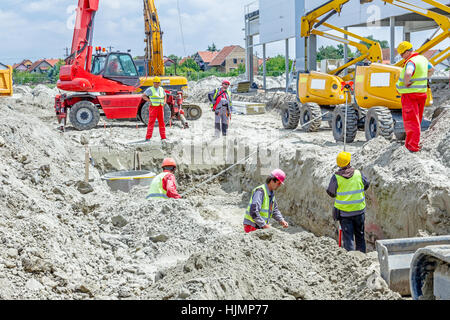 Zrenjanin, Vojvodina, Serbia - May 29, 2015: Assembly process concrete reinforcement housing for drainage waste - Stock Photo
