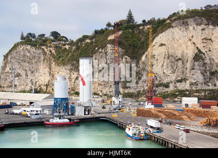 The port view with a lookout cliff in Napier town (New Zealand). - Stock Photo