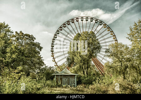 Old big wheel in an abandoned amusement park, Spreepark, East Berlin, Treptow, - Stock Photo