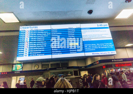 A digital Amtrak and NJ Transit departure board in Penn Station in New York on Monday, January 23, 2017 shows train - Stock Photo