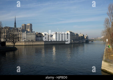 River Seine, Paris looking from Quai de l'Hotel de ville across the bridge to Notre Dame Cathedral. - Stock Photo