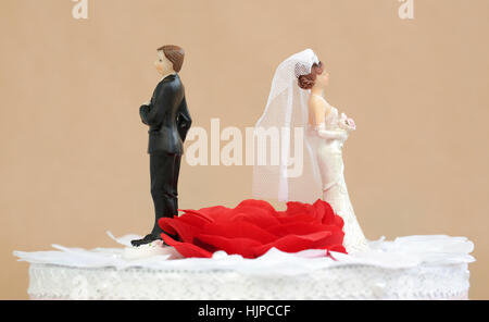 A divorced couple on top of a wedding cake - Stock Photo