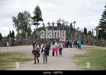 Visitors at the Hill of Crosses, near Siauliai, Lithuania - Stock Photo