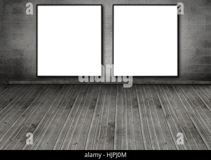 Grey posters on dark wall above cabinet with candles and