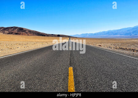 Straight Road leading to the horizon - Stock Photo