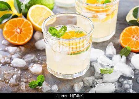 Citrus fruit lemonade in glasses - Stock Photo