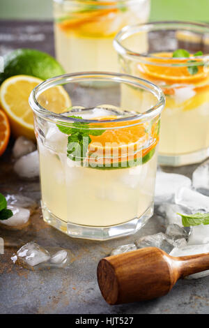 Refreshing summer cocktail with citrus fruits - Stock Photo