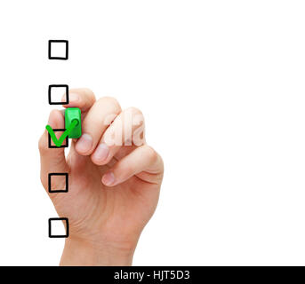 Hand putting check mark with green marker on blank survey checklist on transparent glass board. - Stock Photo