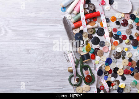 Background of old tools for sewing close up on wooden board top view horizontal - Stock Photo