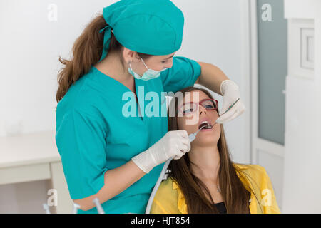 Young woman patient at the dentist - Stock Photo
