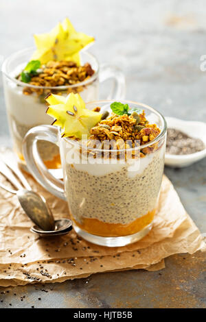 Chia pudding with exotic fruits and granola - Stock Photo