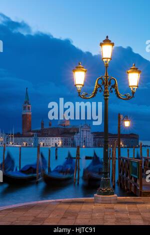 Early morning view over Gondolas and San Giorgio Maggiore, Venice, Veneto, Italy - Stock Photo