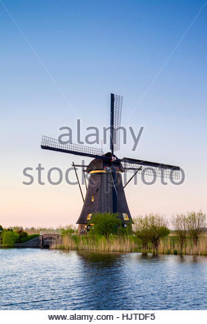 Netherlands, South Holland, Kinderdijk, UNESCO World Heritage Site. Historic Dutch windmills on the polders at sunset. - Stock Photo