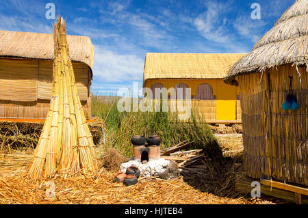 Houses on one of the Uros Floating Islands on Lake Titicaca in Peru - Stock Photo