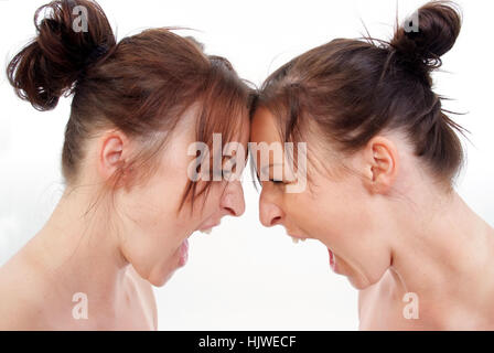 Twins screaming each other - Stock Photo