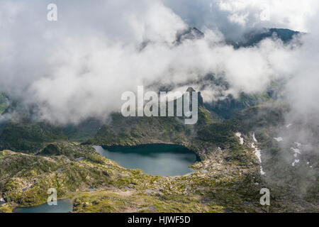 Clouds passing over a ridge by a mountain lake, view from Greifenberg, Upper Klaffersee, Klafferkessel, Schladminger - Stock Photo
