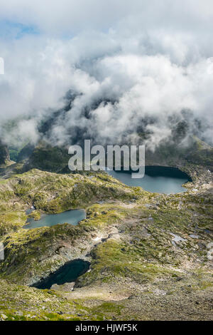 Clouds passing over a ridge with mountain lakes, view from Greifenberg, Upper Klaffersee, Klafferkessel, Schladminger - Stock Photo