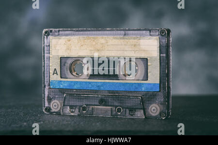 close up of old audiocassette on dark background - Stock Photo