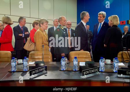 U.S. Secretary of State John Kerry chats with North Atlantic Treaty Organization Secretary-General Jens Stoltenberg - Stock Photo
