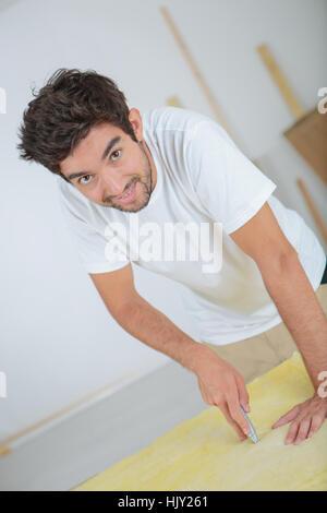 Man using stanley knife - Stock Photo