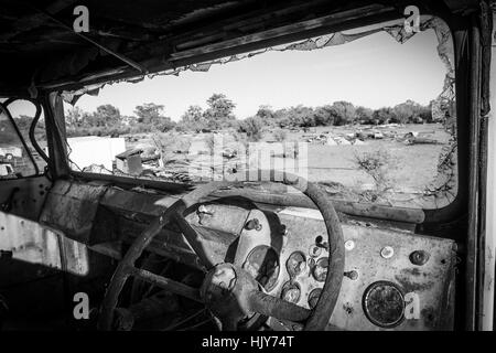 View through the windscreen of an abandoned truck onto a desert wasteland in outback New South Wales, Australia - Stock Photo