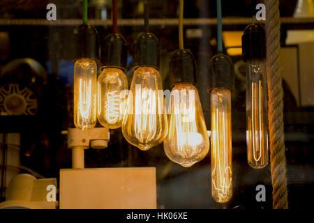 ... Decorative antique edison style filament light bulbs hanging - Stock  Photo