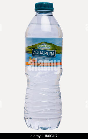 A bottle of Aqua Pura mineral water on a white background - Stock Photo