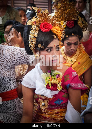 Girl awaiting tooth filing ceremony, Denpasar, Bali, Indonesia, Southeast Asia - Stock Photo