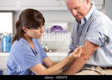 Doctor Giving Male Patient Injection - Stock Photo