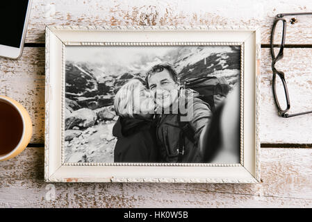 Black-and-white photo of senior couple in white picture frame. - Stock Photo