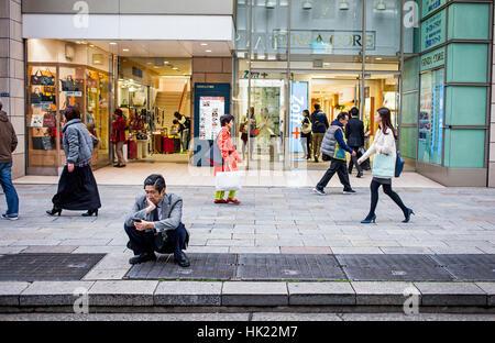 Street scene, Chuo street, Ginza, Tokyo, Japan. - Stock Photo