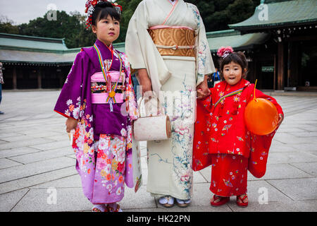 Quimono, girls and woman,Shichi-go-san ritual, in Sanctuary of Meiji Jingu, Tokyo, Japan - Stock Photo
