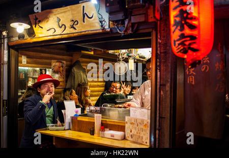 Restaurant in Omoide Yokocho, Tokyo, Japan - Stock Photo